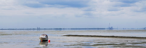 Harbor in sight. Landscape on the north sea part while an ebb Royalty Free Stock Image