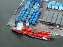 Harbor from the sky. Helicopter view of Antwerp harbor, with a huge tanker ship Stock Photography