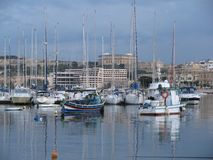 In the harbor of Sliema, there are magnificent yachts. Malta. In the bay of Sliema there are many yachts. Sports and pleasure yachts in the harbor are waiting Stock Photo