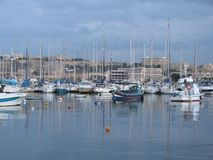 In the harbor of Sliema, there are magnificent yachts. Malta. In the bay of Sliema there are many yachts. Sports and pleasure yachts in the harbor are waiting Royalty Free Stock Photography