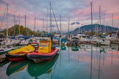 Harbor in Squamish town, British Columbia, Canada. At the evening light. Sunset time in harbor. Fishing boats in harbour stock photos