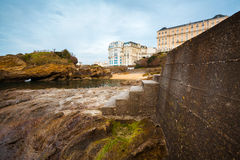 Harbor Stairs. Concrete stairs at Biarritz harbor, France, Pays Basque. Typical french buildings at the background Royalty Free Stock Photos