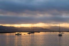 Harbor Sunrise. Sailboats anchored in the harbor at sunrise Royalty Free Stock Photos