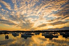 Harbor sunrise and clouds. Beautiful clouds and early morning sunlight as dawn breaks over Bass Harbor, Maine Royalty Free Stock Photos