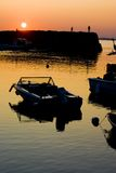 Harbor Sunset. Scenic view of boats moored in a small harbor in Rockport, Massachusetts during a sunset Stock Photo