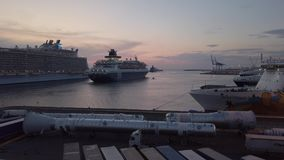 Harbor at  sunset with cruise ship exit out the way to travel in the night stock video