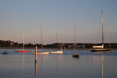 Harbor at sunset. Small boats in a harbot at sunset Stock Image
