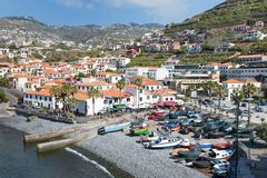 Harbor with tourists and fishing ships at Funchal, Portugal Royalty Free Stock Image