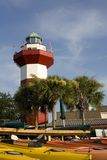 Harbor Town Lighthouse in Hilton Head. The historic Harbor Town Lighthouse in Hilton Head South Carolina. Colorful kayaks are in the foreground. Plenty of copy Stock Photo