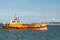 Harbor tug on the sea Stock Photos