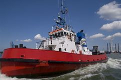 Harbor tugboat. Closeup of a harbor tugboat in motion, taken in Rotterdam on a sunny day stock images