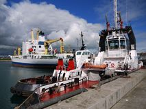Harbor Tugs Standby. Harbor Tugs on standby for cargo ship movements in port Stock Photos
