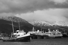 Harbor of Ushuaia on the Beagle Channel. USHUAIA - JANUARY 2, 2014 : The Harbor of Ushuaia on the Beagle Channel. The channel was named after the ship HMS Beagle Royalty Free Stock Photos