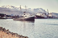Harbor in Ushuaia city, Argentina. Harbor in Ushuaia city, commonly known as the southernmost city in the world, color toned picture, Argentina Royalty Free Stock Photography
