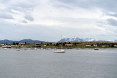 In the Harbor of Ushuaia - the southernmost city of the Earth. USHUAIA, ARGENTINA - NOVEMBER 17,2014:In the Harbor of Ushuaia - the southernmost city of the Stock Photos