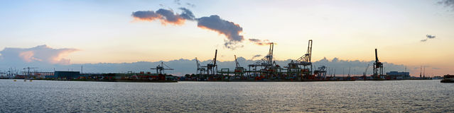 Harbor view. Panoramic image of a commercial harbor area at dusk on a very quiet day royalty free stock photo