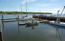 Harbor view at Belfast, Maine. View of the dockage at Belfast Maine with sailboats and a mooring barge stock image