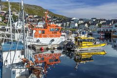 The harbor view of boats and Honningsvag cityscape in Mageroya island.  Nordkapp Municipality in Finnmark county