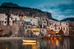 Harbor view in Cefalu at dusk. Beautiful harbor view of old houses in Cefalu at dusk, Sicily Royalty Free Stock Photo