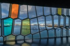 Harbor view through Harpa Concert Hall windows. Old Harbor view through Harpa Concert Hall windows in Reykjavik, Iceland Royalty Free Stock Photos