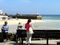 Harbor view, St.Ives, Cornwall. Tourists resting and chatting overlooking the harbor at St.Ives, Cornwall, England, UK Stock Images
