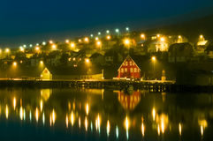 Harbor village houses and boats. Night with beautiful lights. Iceland. Stock Images