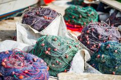 Fishing nets in Marsaxlokk harbour in Malta. The harbor in the village of Marsaxlokk in Malta, renowned for its colorfully decorated fishing boats Royalty Free Stock Photo
