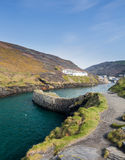 Harbor wall in Boscastle Cornwall. Harbour wall leading up to old houses and cottages in Boscastle, Cornwall, England, UK Stock Photography