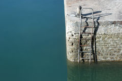 Harbor wall with steel ladder Stock Images