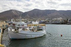 The harbor wharf in Hersonissos, Crete. Port with fishing boats. stock image