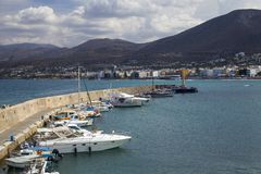The harbor wharf in Hersonissos, Crete. Port with fishing boats. royalty free stock photos