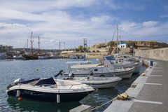 The harbor wharf in Hersonissos, Port with fishing boats and sailing boats. royalty free stock photo