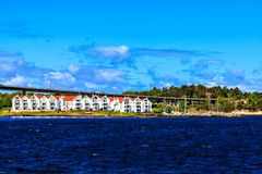 Harbor, white houses and bridge, Norway Royalty Free Stock Photo