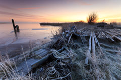 Harbor in winter and a beautiful sunrise Stock Images
