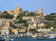 Harborr of Gozo, Maltese islands. Boats in harbor near Gozo island, Malta Stock Photo