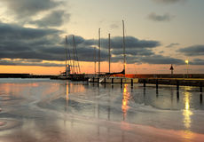Harbour. A winter evening with ice in water Stock Photo