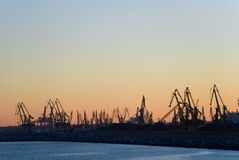 Harbour. Silhouettes of cranes at sunset. Constanta harbour Royalty Free Stock Photo