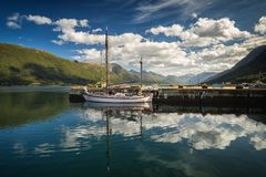 Harbour in Andalsnes, norwegian summer, beautiful reflections of sky and boat stock photos