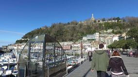 Harbour area with promenade and boats moored at the port of Donostia-San Sebastian stock footage