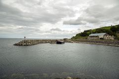 Harbour and barge nort west coast of ireland. A harbour with barge docked Royalty Free Stock Images