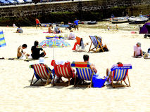 Harbour beach, St.Ives, Cornwall. A typical British seaside beach holiday on the sands at St.Ives, Cornwall, England, UK Royalty Free Stock Photography
