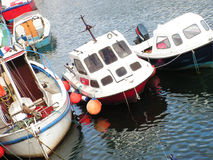 Harbour Boats. Small boats in a harbour tied up together Stock Photography