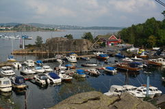 Harbour and boats on fjord Kristiansand, Norway Royalty Free Stock Photo
