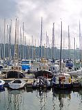 Harbour and boats, Ireland. Kinsale Harbour and boats in the early evening light on a cloudy day stock photos