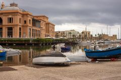Harbour with boats and and yachts in Bari, southern Italy. Marina landscape. Palace and port in Bari. Mediterranean seafront. stock images