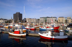 Harbour of Bodo, Norway. Fishing ships in harbour of Bodo, Norway with modern buildings on the background Royalty Free Stock Photos