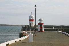 Harbour breakwater lights. Lights on the breakwater at Castletown on the Isle of Man stock photos