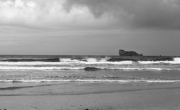 Harbour at Bretagne, France. Black and white image of stormy day on the sea. There are rocky island in Bretagne, Finistere, France royalty free stock images