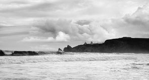 Harbour at Bretagne, France. Black and white image of stormy day on the sea. There are rocky island in Bretagne, Finistere, France stock image