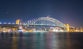 Harbour bridge lights up in Vivid Sydney festival in Sydney, New South Wales, Australia. The Sydney Harbour Bridge is a steel through arch bridge across Sydney Stock Photography